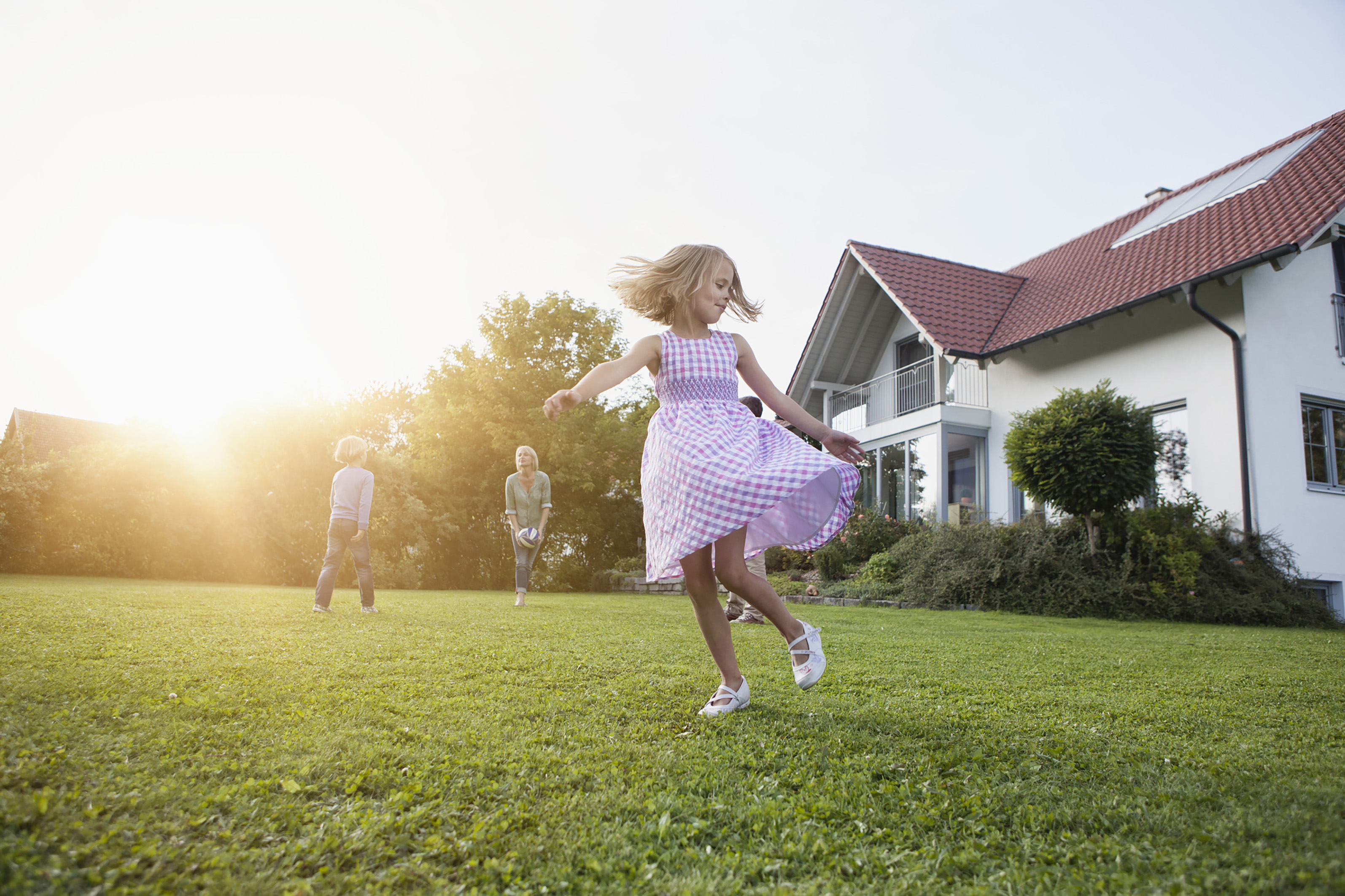 Image-of-a-girl-dancing-in-a-beautiful-garden-with-her-family-enjoying-activities-in-the-background-safe-in-the-knowledge-the-WPL-Diamond-compact-package-sewage-and-wastewater-treatment-plant-is-Simple-Reliable-and-Discreet – UK campaign