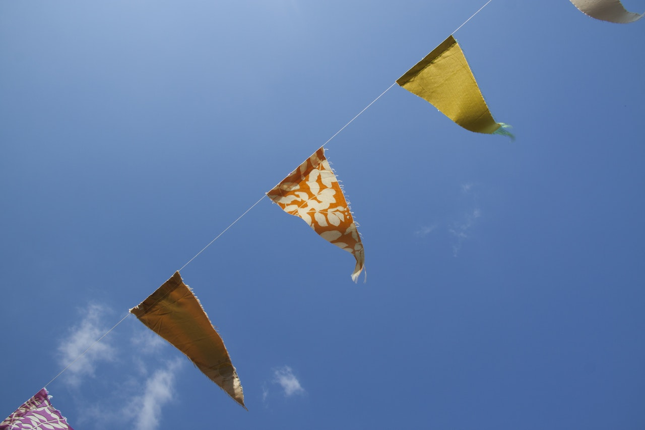 WPL Diamond - Image of bunting against blue sky
